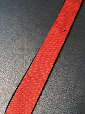 Orange strip pinned to black strip
